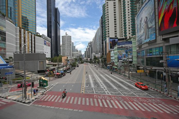 Asoke junction along Sukhumvit Road, usually jammed with traffic, is dead as people work from home during the lockdown. (Photo: Varuth Hirunyatheb)