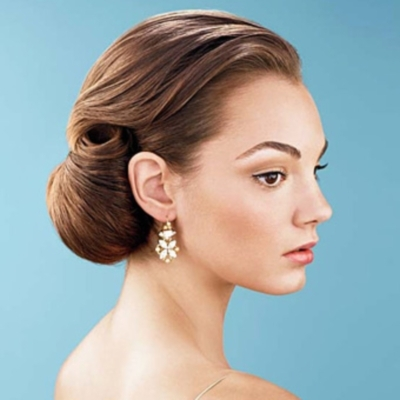 the typical side bun wedding hairstyle made romantic for your wedding bride sparkle