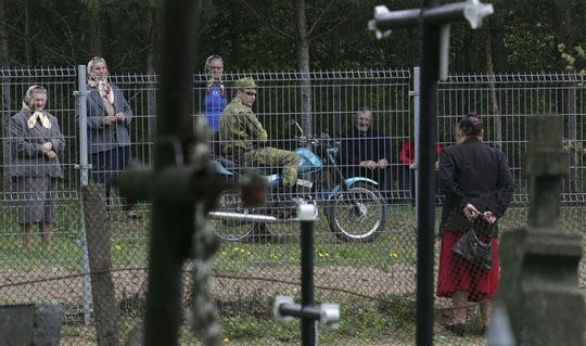 The Woman At Right Is Standing In The Lithuanian Village Of Norviliskes To Speak With Her Belarusian Relatives Across The Fence On The Border Between Belarus And Lithuania