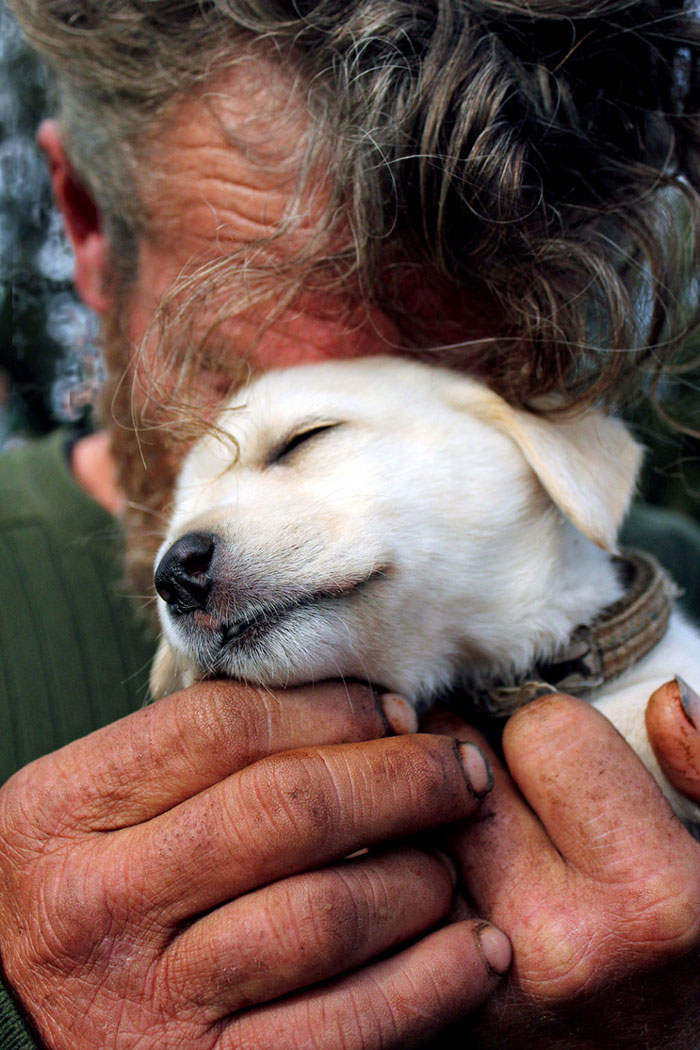 This Homeless Man Hid His Face In His Puppy Because He Was Too Embarrassed To Let The Photographer See His Tears