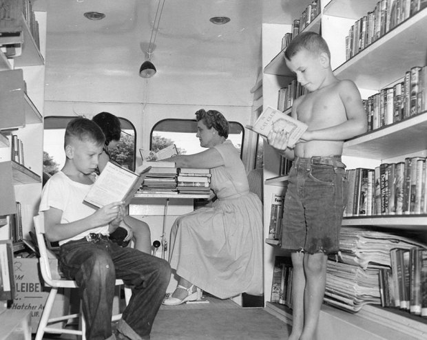 Craig Medvigny (left) And David Sutton Enjoying A Book; Eleanor Mann Substitute Traveling Branch Librarian, C. 1920s