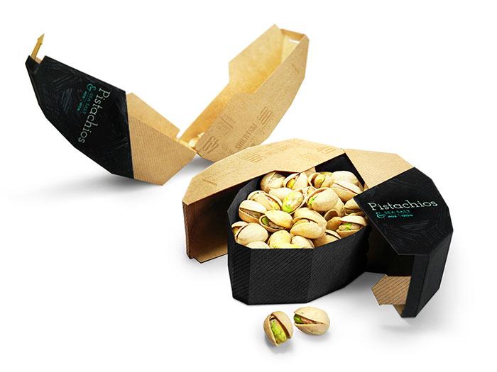 Embalagem para nozes de pistache.  Dentro da bandeja segura Pistachios, mas a parte externa se separa e torna-se uma bandeja para as conchas
