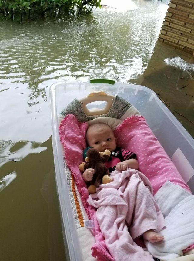 Floater Baby - Mother Who Was Waiting For Rescue During The Hurricane Shared A Picture Of Her Baby Floating In A Large Plastic Container