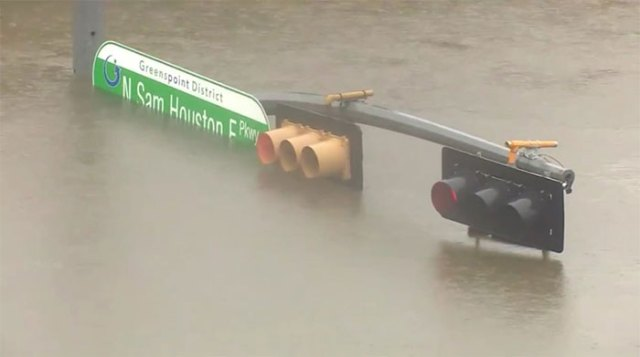 Intersection Along San Houston Pkwy. In Houston, Water About 17 Feet Deep