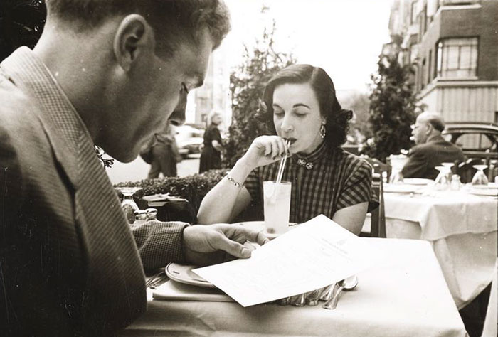 At An Outdoor Cafe With A Woman, 1948