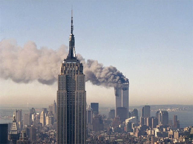 Twin Towers Of The World Trade Center Burn Behind The Empire State Building