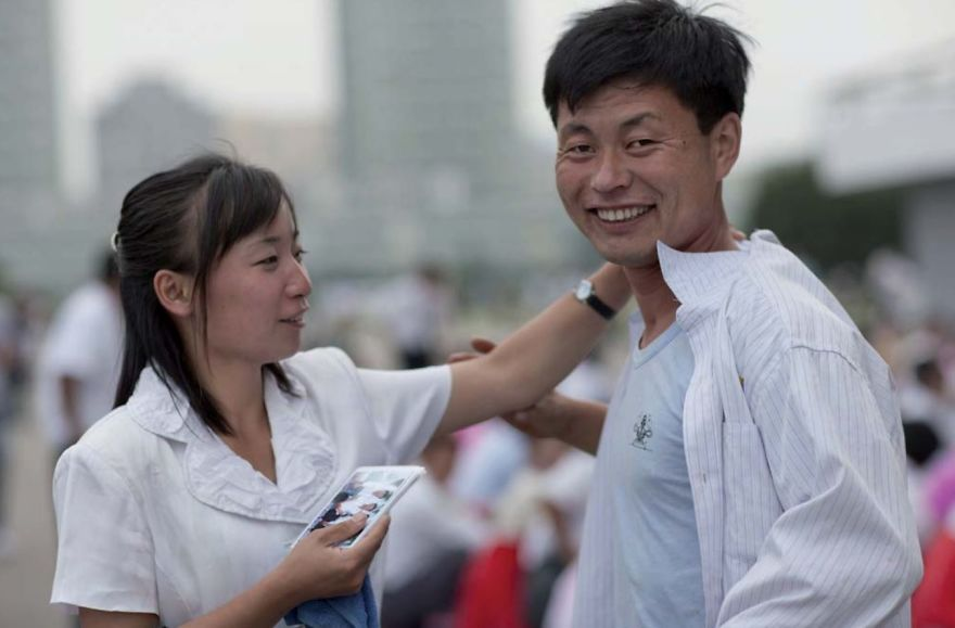 The Way You Dress Is Very Important In North Korea. In Town, You'll Never Find Anybody Dressed Poorly. On This Day, Students Were Dancing In A Park. When I Asked To Take A Picture, The Girl Asked The Man To Straighten His Shirt