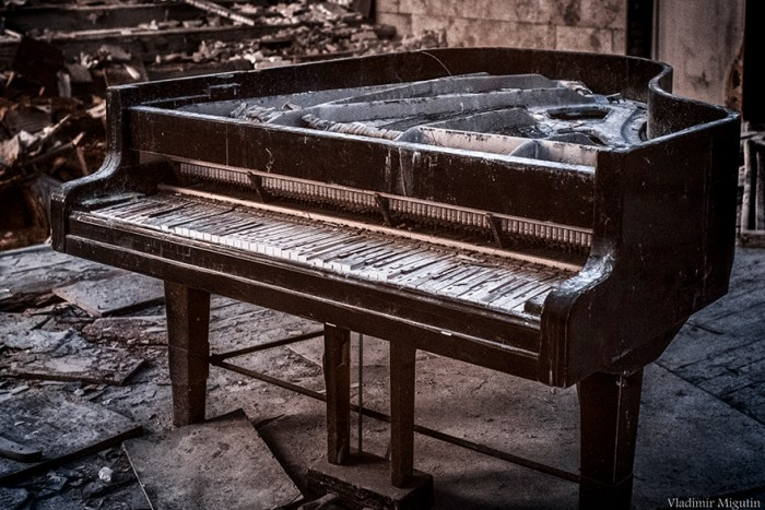 The Rotting Grand Piano In The Concert Hall Of The Abandoned Town Of Pripyat