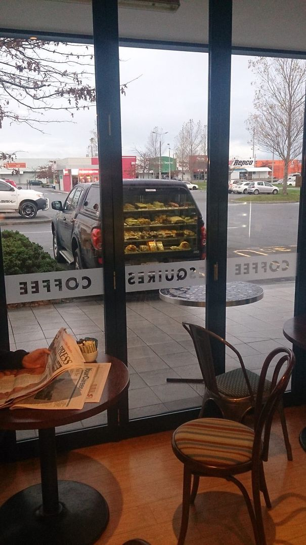 Mirage Of Coffee Shop Window Makes It Look Like This Car Sells Pies Out Of The Boot