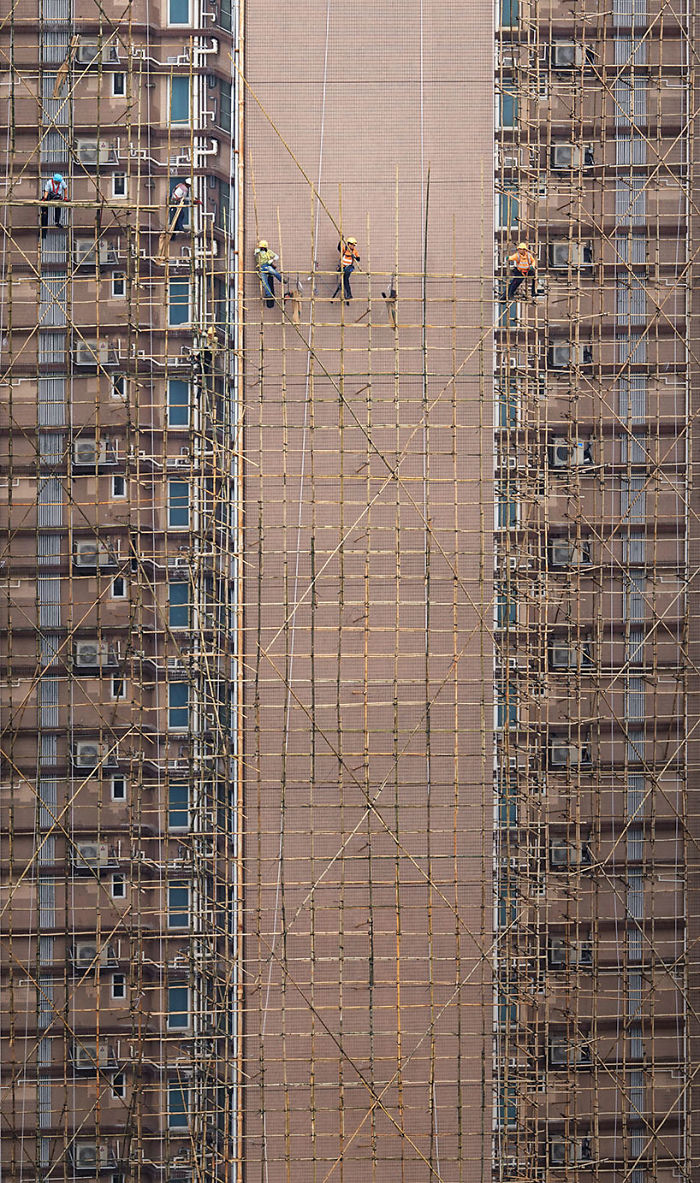 """""""Bamboo Weavers,"""" Workers Are Setting Up The Bamboo Scaffolding That Will Be Used For The Building's Facade Restoration"""