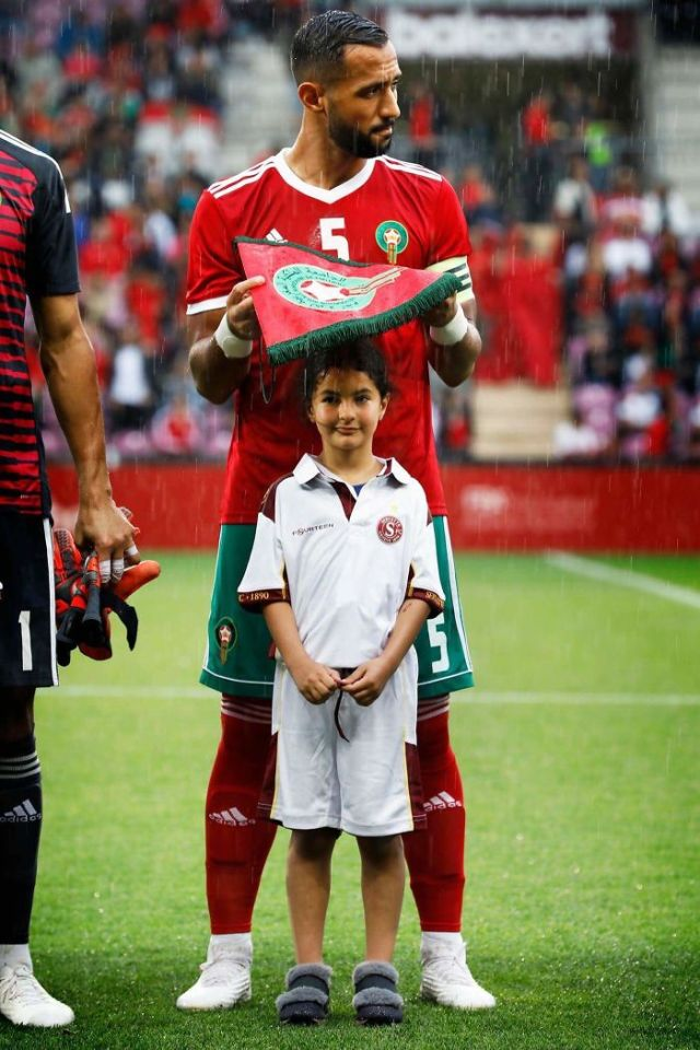 Moroccan Soccer Player Medhi Benatia Protecting A Little Girl From The Rain