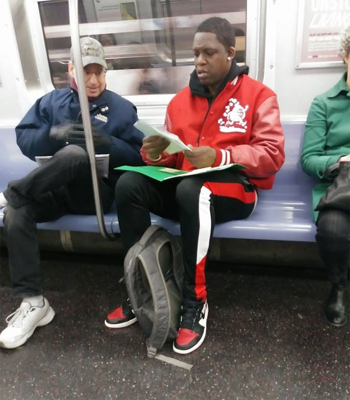 Man In Red Needed Help With Son's Math Homework And Got It From A Stranger On The Subway