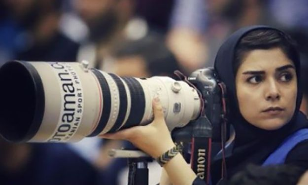 banned-from-stadium-iranian-female-photographer-shoots-football-match-roof14-5b7289cb195d0__700 The Way This Female Journalist Bends The Rules After Getting Banned From Stadium Is Genius Design Photography Random