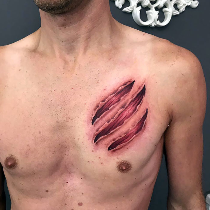 Scratched Chest Tattoo