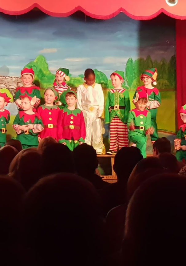 These Kids Were Asked To Dress Up As Elves For Their School Play. One Kid Dressed Up As Elvis