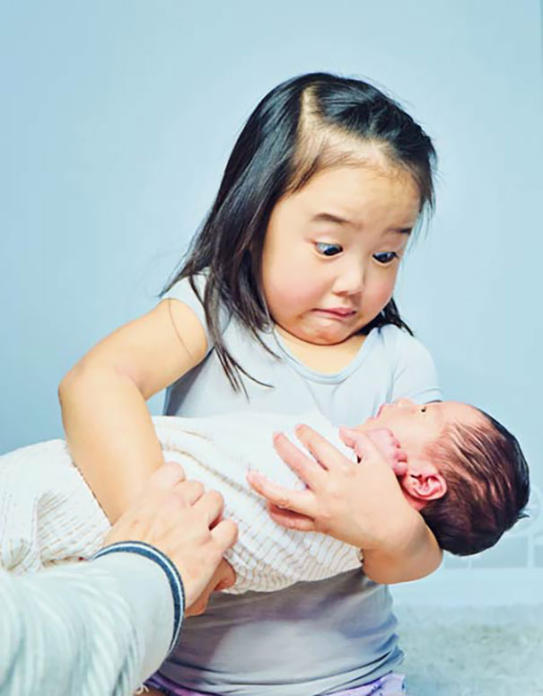 My Daughter's Reaction When Holding Her New Baby Sister. Much Heavier Than The Dolls She Practiced On
