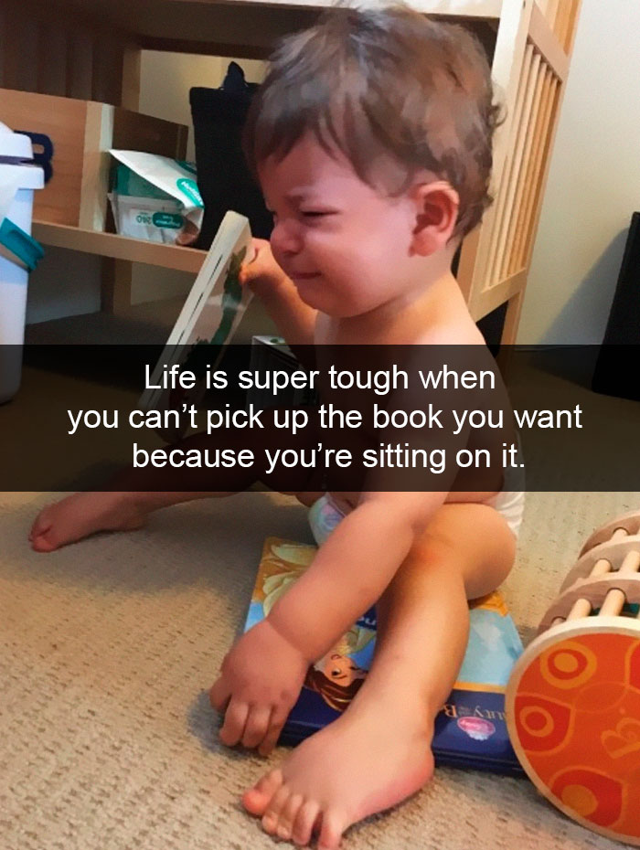 Life Is Super Tough When You Can't Pick Up The Book You Want Because You're Sitting On It