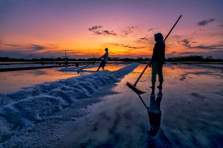 Salt Farmer During Sunset
