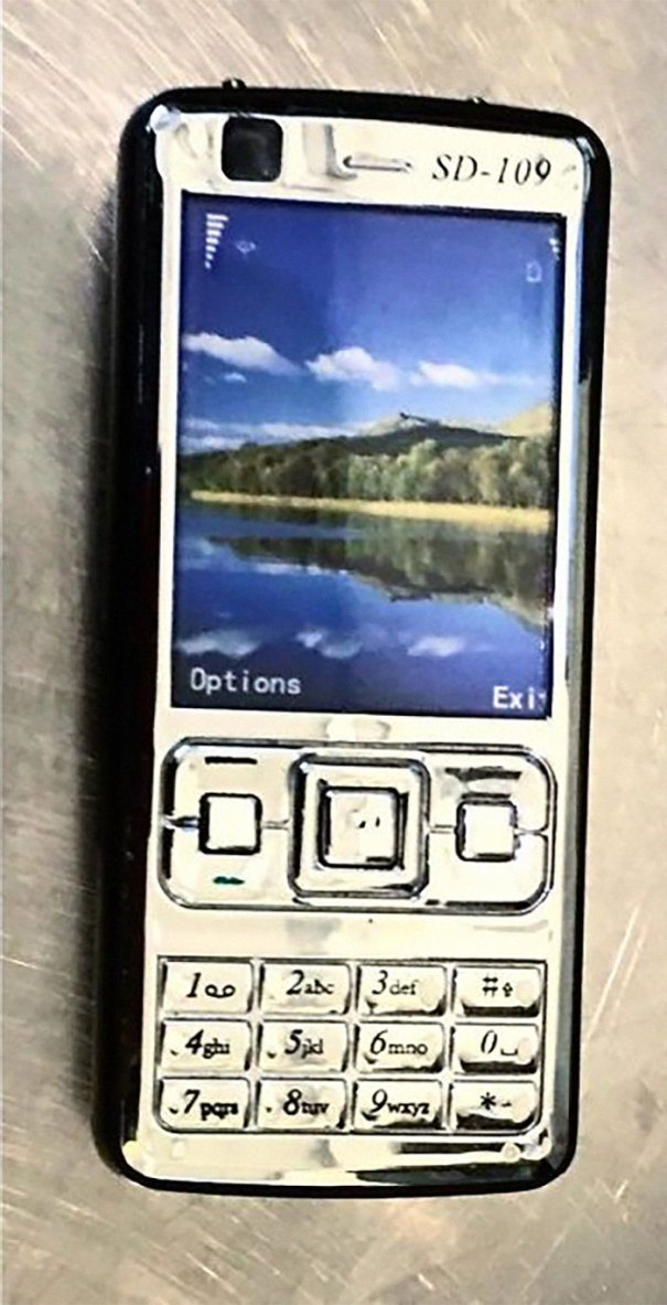 Does This Phone Look Suspicious To You? Well, Besides The Fact That Borat And Idiocracy Were Still In Theaters When This Style Of Phone Was Popular, There's Something Else Strange About It. It's A Stun Gun With Shockingly Good Reception!