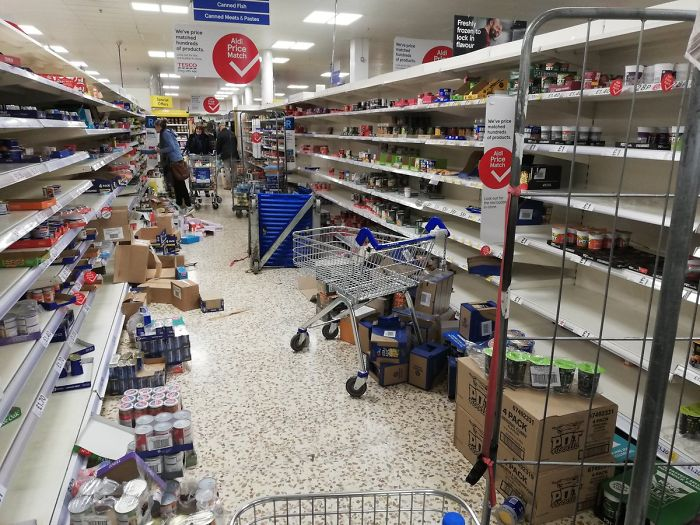 Empty And Messy Shelves At A Tesco Supermarket After Panic Buying