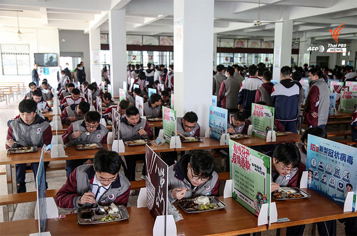 In China Students Eat Lunch By Themselves, With Dividers Set Up Between Them