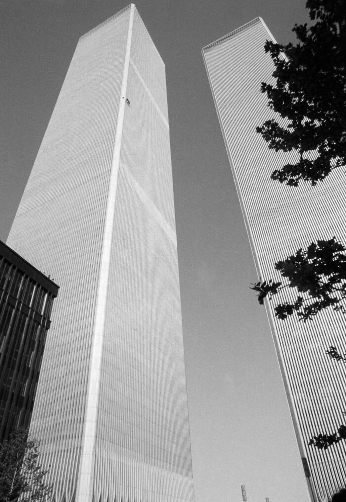 """Human Fly"" George Willig Scales The Exterior Of The World Trade Center's South Tower In 1977. Completing The Climb In 3.5 Hours, He Was Arrested At The Top After Signing Several Autographs, And Was Fined $1.10 By The City - A Penny For Each Floor He Passed"