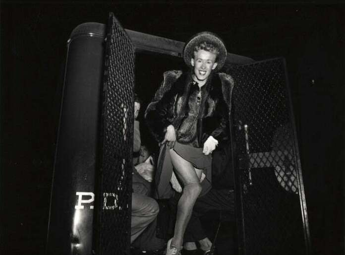 A Man Arrested For Cross-Dressing Emerging From A Police Van, New York, 1939