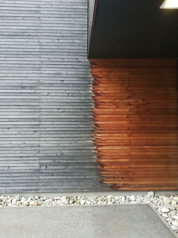 The Same Wooden Cover On The Building, But One Part Is Under The Balcony. 10 Years Of Weather