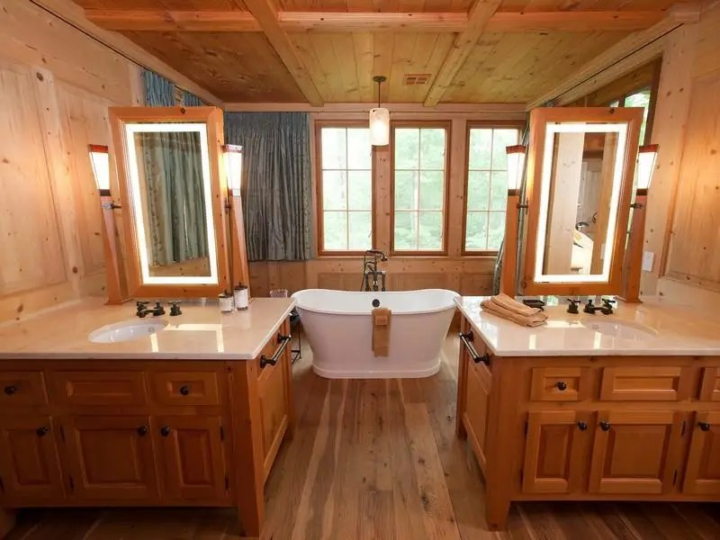 The home has five full bathrooms and one half bath. The 6,590-square-foot house has four fireplaces and three exterior stone patios.