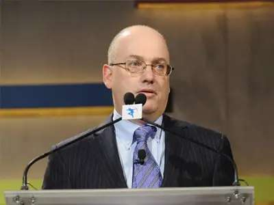 Steve Cohen worked in the produce section of a grocery store.