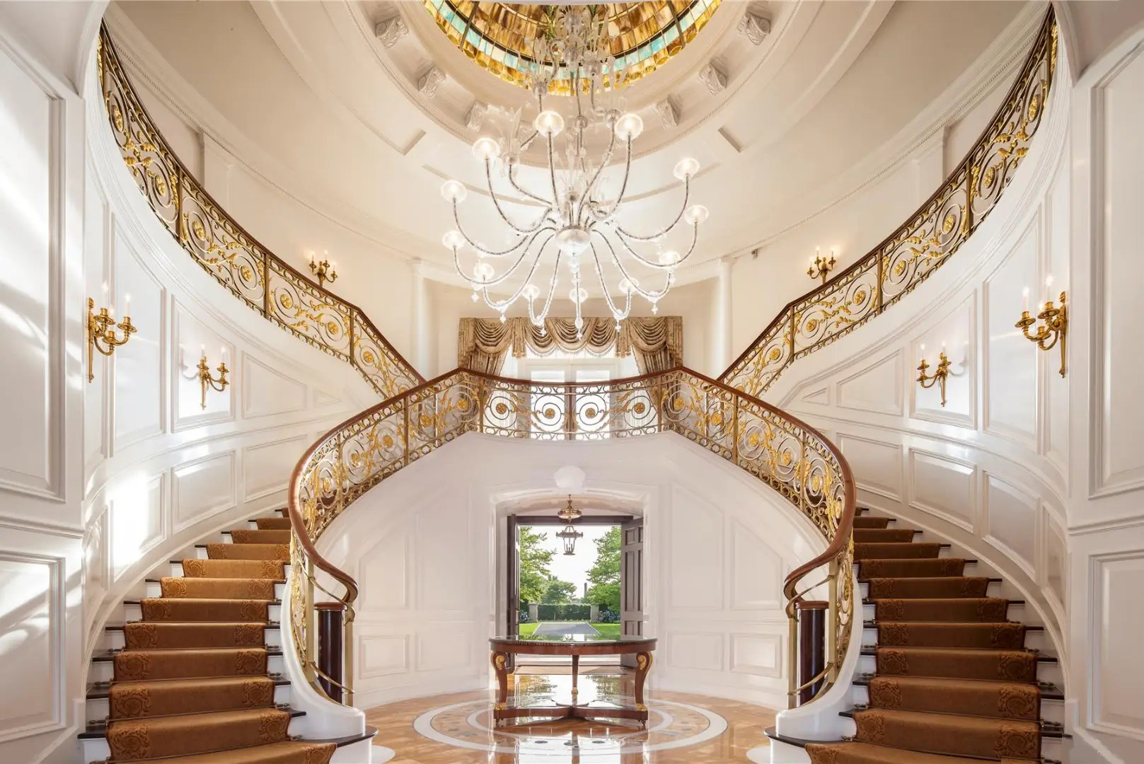 Inside, the grand staircase makes quite the impression.