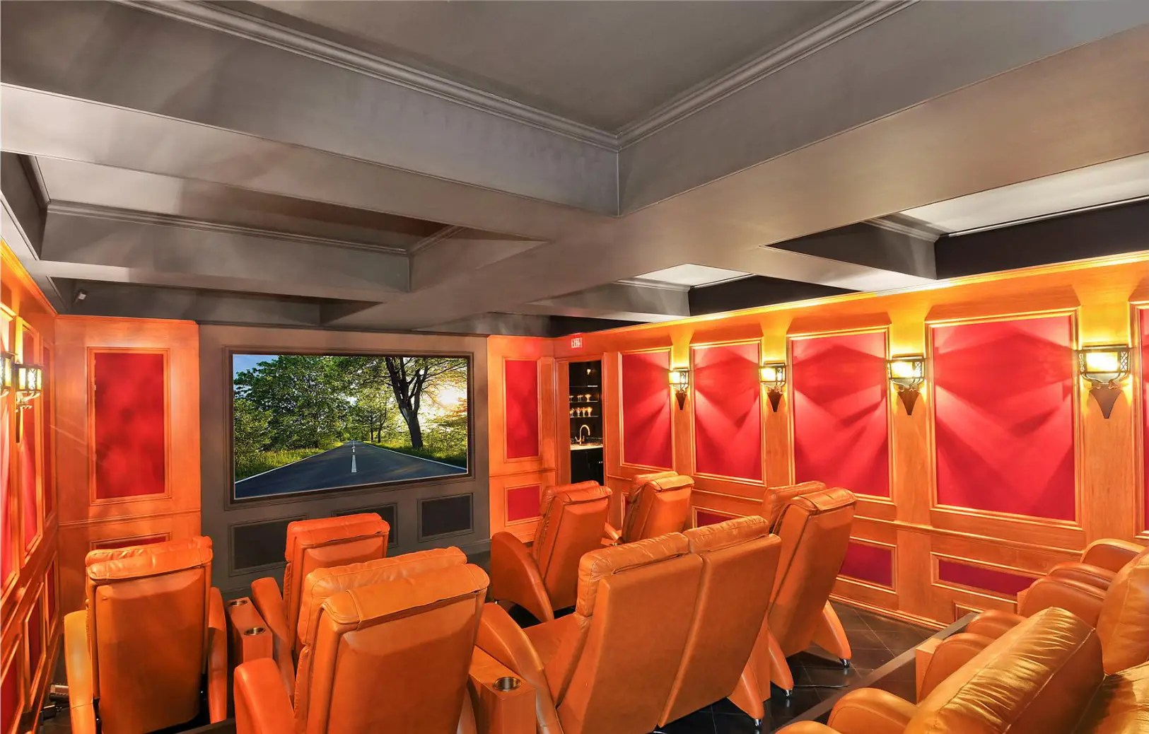 Check out the deluxe movie theater with multiple rows of plush lounge chairs.