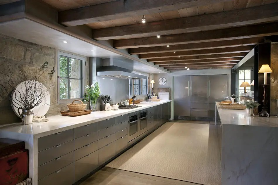 The kitchen is modern, with ample storage space and a chef's stove.