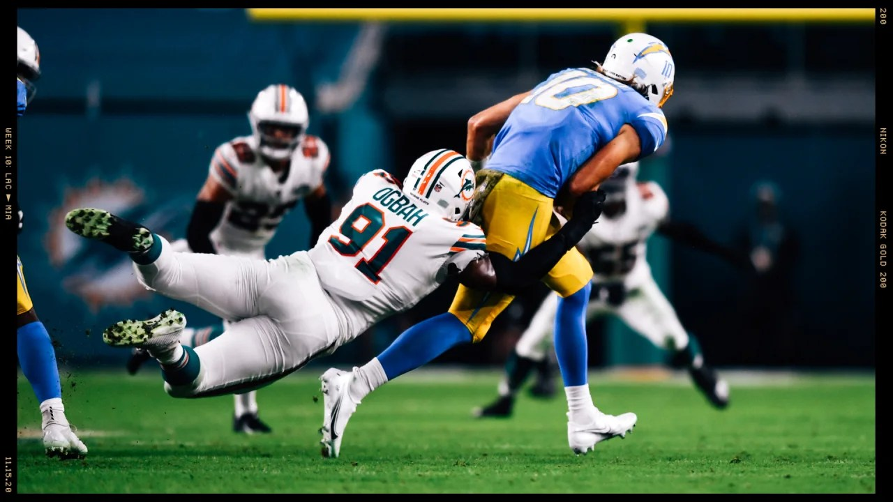 Emmanuel Ogbah tackles Chargers' Quarterback Justin Herbert.