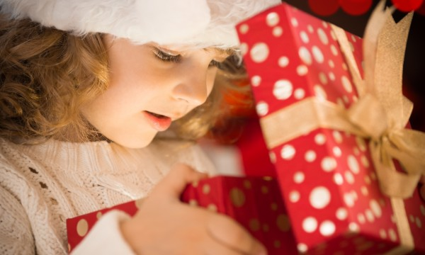 Image result for image of a girl's christmas wrapped present