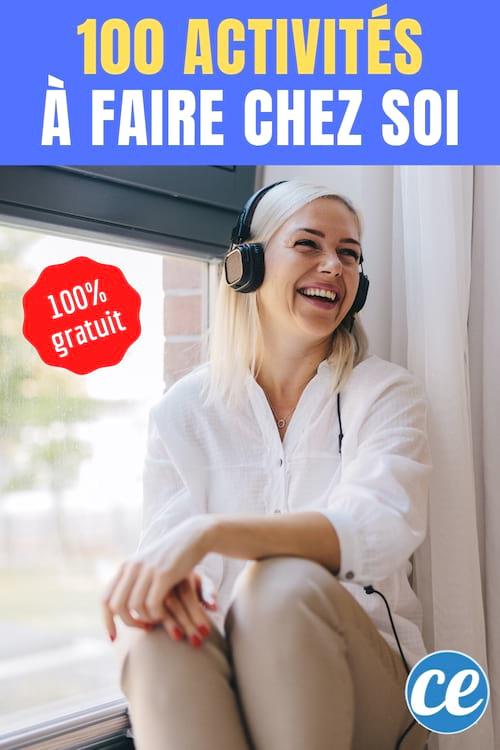 Une femme écoute de la musique avec des écouteurs près de sa fenêtre
