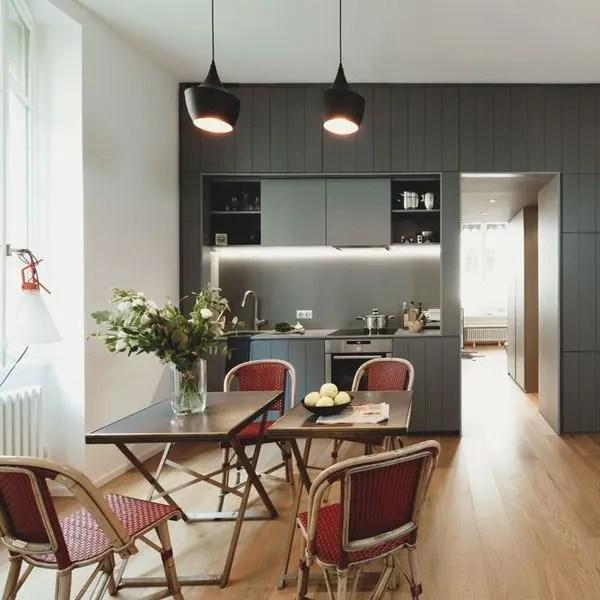 agrandir une cuisine discrete et minimaliste qui s ouvre sur la salle a manger