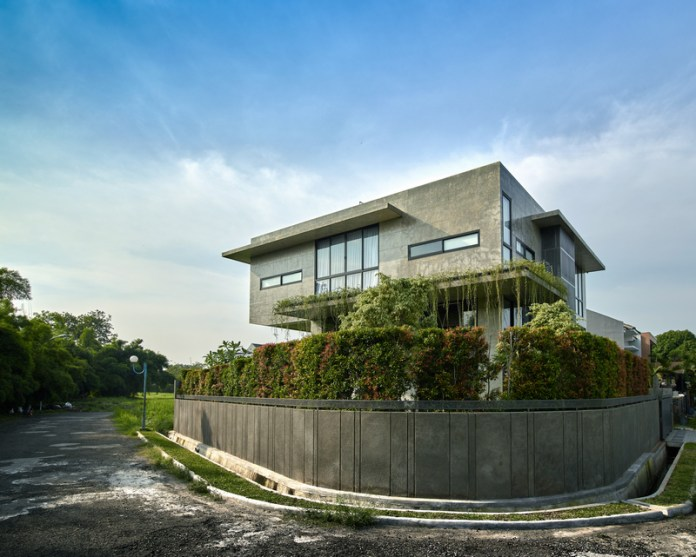 Raw Architecture Designs A Tropical House Around A Square Grid In Jakarta