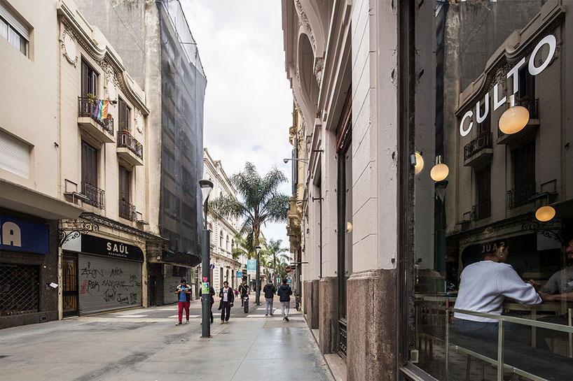 green walls and yellow zinc details decorate taller capitan's coffee shop in uruguay designboom