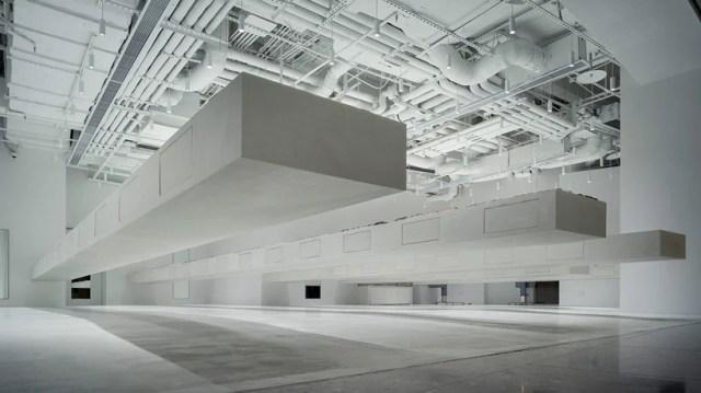 junya ishigami creates 12-meter cantilevered display shelves for JINS eyewear store
