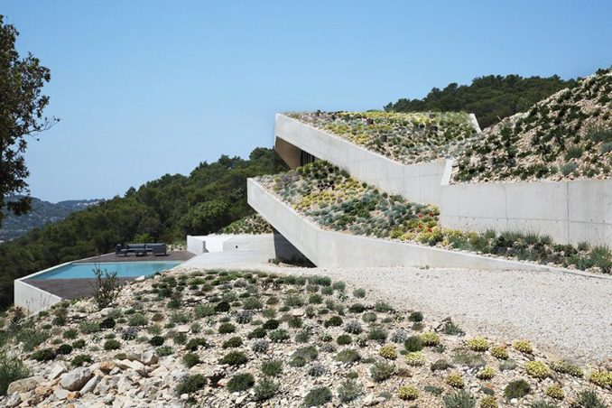proarh envisions concrete family retreat as artificial grotto on the croatian island of vis