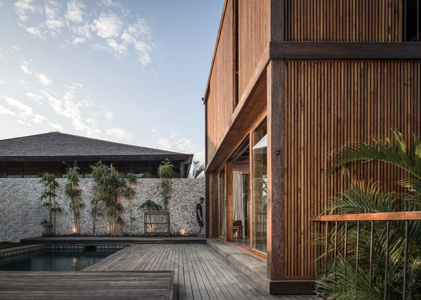 alexis dornier builds house in bali with reused timber + façade of movable screens