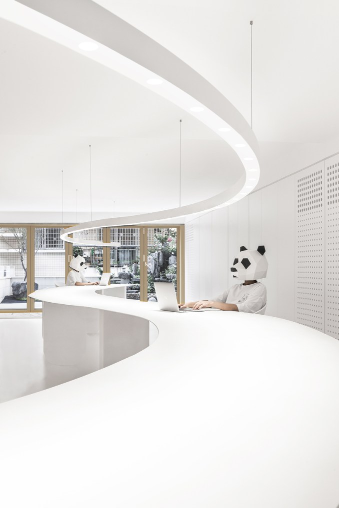 panda design builds a new office around a curved workspace in xiamen, china designboom