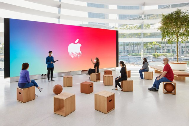 apple officially unveils its floating marina bay sands store in singapore