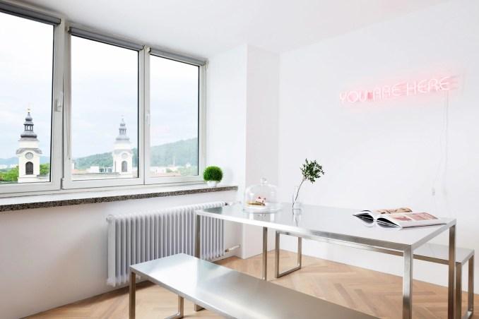 Arhitektura d.o.o. refurbishes urban apartment in Ljubljana, Slovenia, originally designed by Edvard Ravnikar
