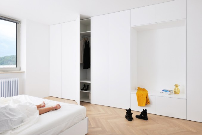 Arhitektura d.o.o. refurbishes urban apartment in Ljubljana, Slovenia, originally designed by Edvard Ravnikar