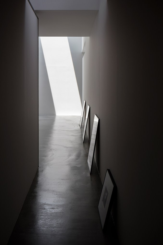 Hallway of corrugated steel house and studio by Japanese studio Form designed by Kouichi Kimura.