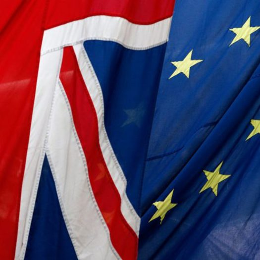 European Union and UK flags fly together.