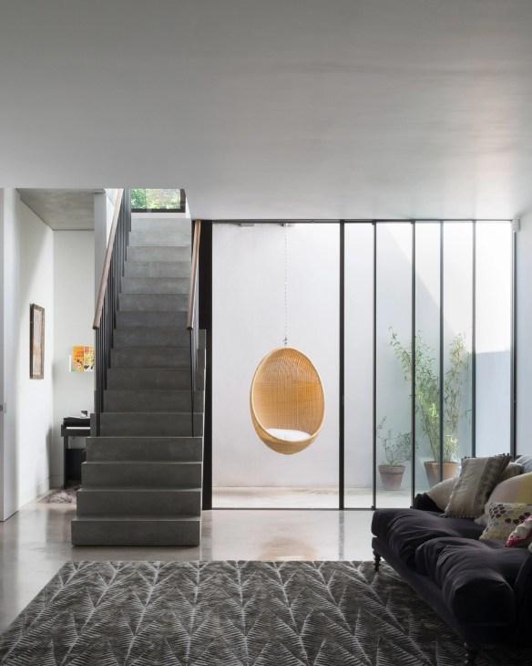 Pre-cast concrete staircase forms centrepiece of basement