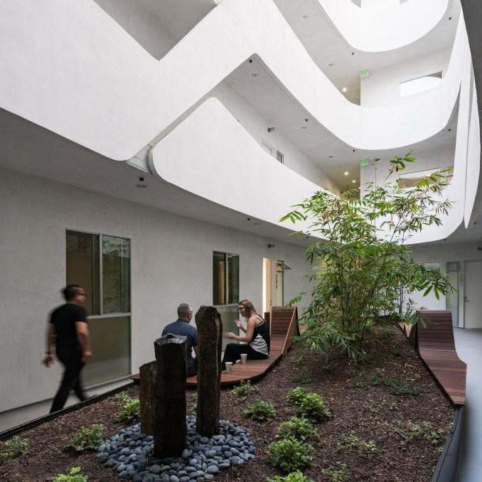 courtyards loha mariposa1038 housing block curvilinear courtyard koreatown los-angeles